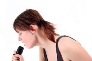 Girl singing with passion